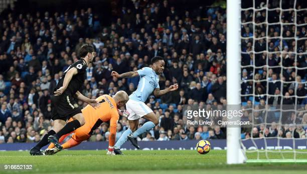 Manchester City's Raheem Sterling goes round Leicester City's Kasper Schmeichel but fails to score during the Premier League match between Manchester...