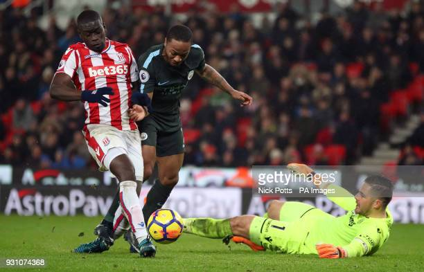 Manchester City's Raheem Sterling is tackled by Stoke City's Bruno Martins Indi as he attempts to go around goalkeeper Jack Butland during the...