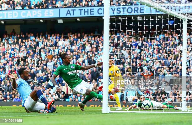 Manchester City's Raheem Sterling scores his sides first goal during the Premier League match between Manchester City and Brighton Hove Albion at...
