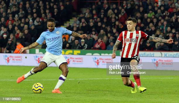 SHEFFIELD ENGLAND JANUARY Manchester City's Raheem Sterling shoots under pressure from Sheffield United's Muhamed Besic during the Premier League...