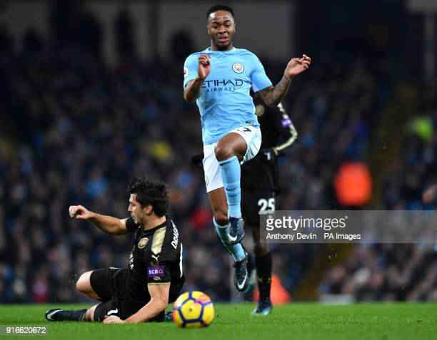 Manchester City's Raheem Sterling skips past a tackle from Leicester City's Aleksandar Dragovic during the Premier League match at the Etihad Stadium...