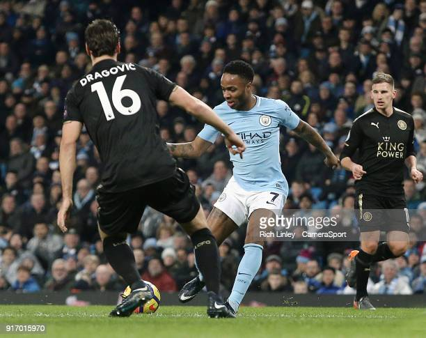 Manchester City's Raheem Sterling under pressure from Leicester City's Aleksandar Dragovic during the Premier League match between Manchester City...