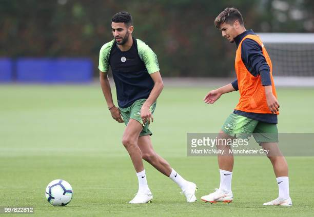 Manchester City's Riyad Mahrez and Brahim Diaz during training at Manchester City Football Academy on July 13 2018 in Manchester England