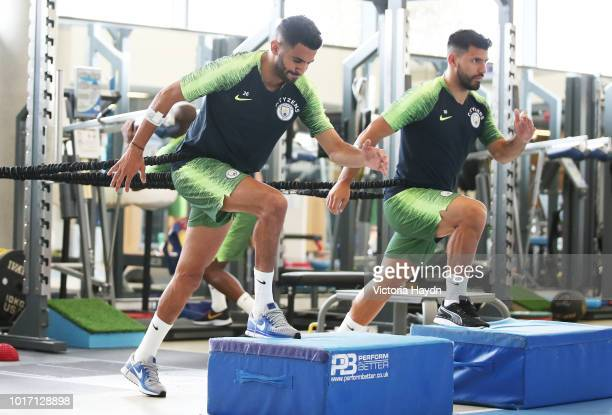 Manchester City's Riyad Mahrez and Leroy Sane during training in the gym at Manchester City Football Academy on August 15 2018 in Manchester England