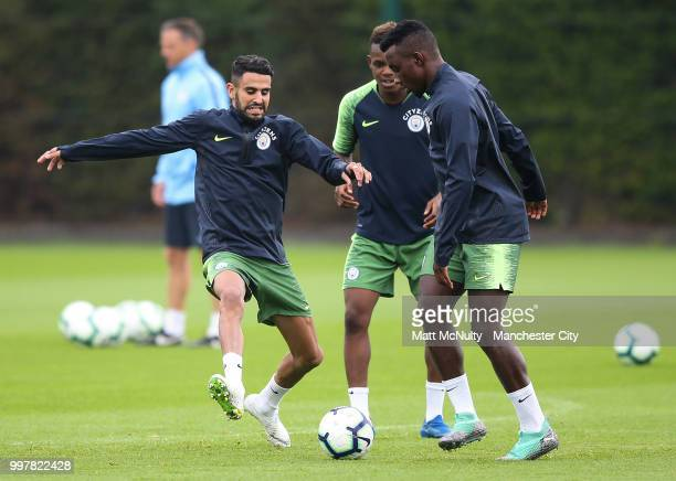 Manchester City's Riyad Mahrez and Thierry Ambrose during training at Manchester City Football Academy on July 13 2018 in Manchester England