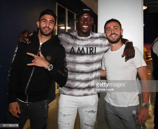 Manchester City's Riyad Mahrez Benjamin Mendy and Bernardo Silva pose for a photo at The Printworks on August 15 2018 in Manchester England