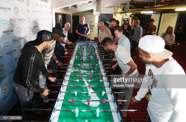 Manchester City's Riyad Mahrez Benjamin Mendy Bernardo Silva and Gabriel Jesus with Manchester City fans at The Printworks on August 15 2018 in...