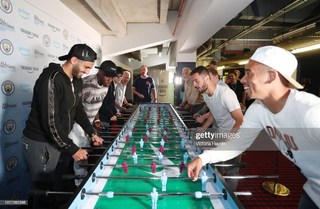 Manchester City's Riyad Mahrez, Benjamin Mendy, Bernardo Silva and Gabriel Jesus with Manchester City fans at The Printworks on August 15, 2018 in Manchester, England.