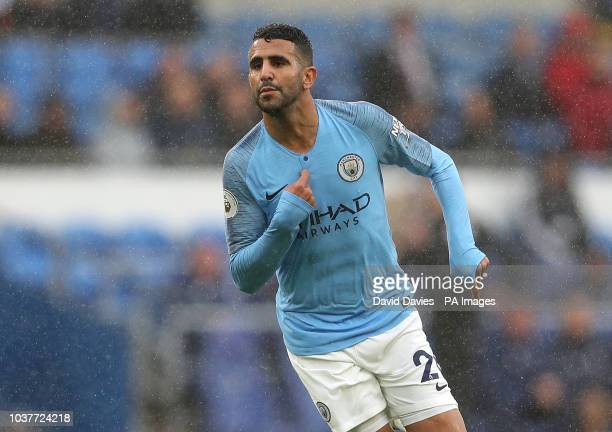 Manchester City's Riyad Mahrez celebrates scoring his side's fifth goal of the game during the Premier League match at The Cardiff City Stadium