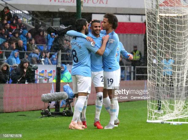 Manchester City's Riyad Mahrez celebrates scoring his side's fourth goal with teammate's Leroy Sane and Ilkay Gundogan during the Premier League...