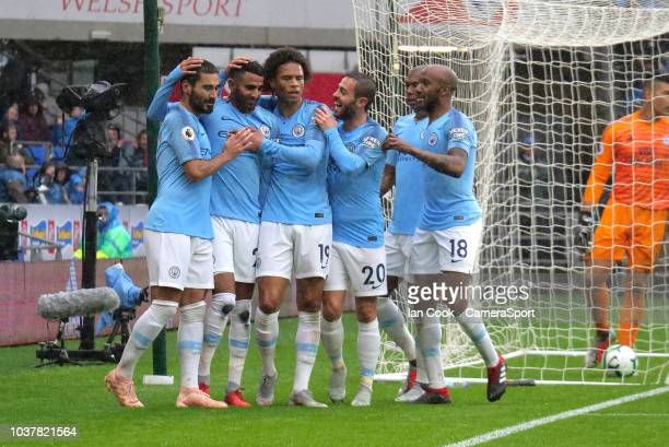 CARDIFF WALES SEPTEMBER Manchester City's Riyad Mahrez is congratulated by his team mates after scoring his sides fourth goal during the Premier...