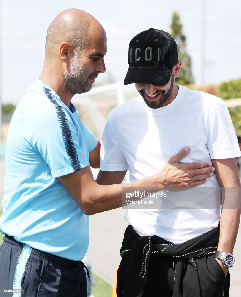 Manchester City's Riyad Mahrez meets Pep Guardiola on his first day at Manchester City Football Academy on July 10, 2018 in Manchester, England.