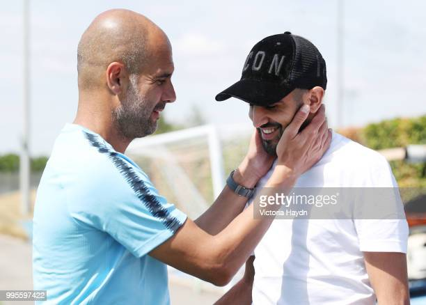 Manchester City's Riyad Mahrez meets Pep Guardiola on his first day at Manchester City Football Academy on July 10 2018 in Manchester England