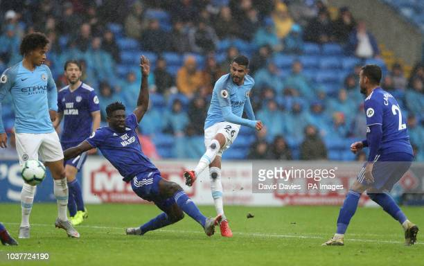 Manchester City's Riyad Mahrez scores his side's fifth goal of the game during the Premier League match at The Cardiff City Stadium