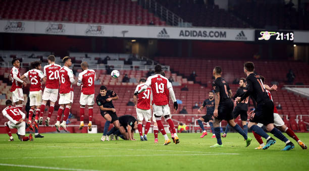 Manchester City's Riyad Mahrez scores his side's second goal of the game during the Carabao Cup, Quarter Final match at The Emirates Stadium, London.
