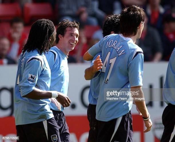 Manchester City's Robbie Fowler celebrates with team mates Kiki Musampa and Stephen Jordan after scoring