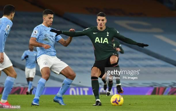 Manchester City's Rodri and Tottenham Hotspur's Erik Lamela battle for the ball during the Premier League match at the Etihad Stadium, Manchester....
