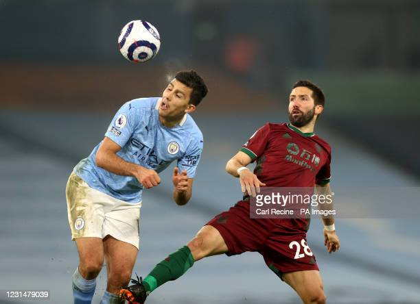 Manchester City's Rodri and Wolverhampton Wanderers' Joao Moutinho battle for the ball during the Premier League match at the Etihad Stadium,...