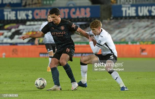 Manchester City's Rodri battles with Swansea City's Jay Fulton during The Emirates FA Cup Fifth Round match between Swansea City and Manchester City...
