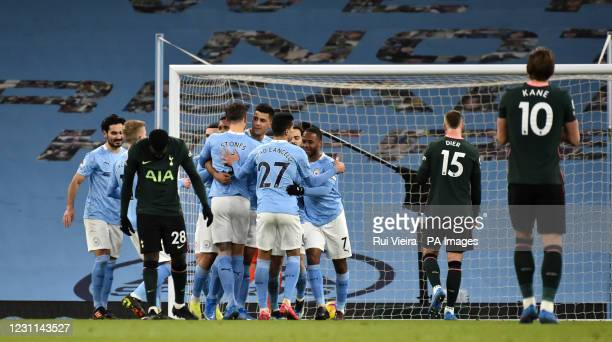 Manchester City's Rodri celebrates scoring their first goal of the game with teammates during the Premier League match at the Etihad Stadium,...