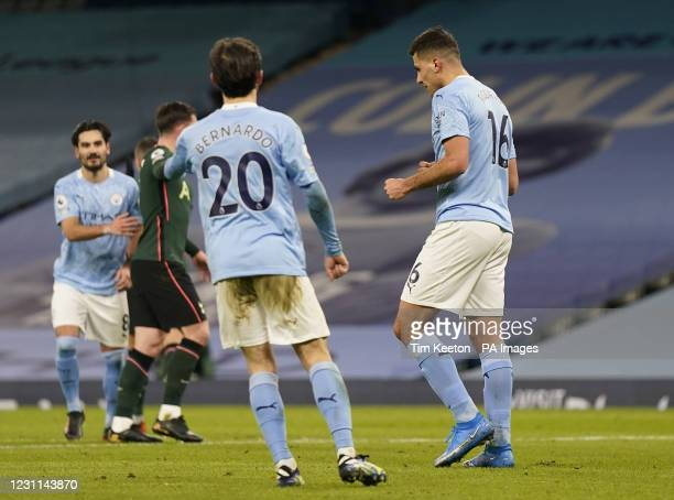 Manchester City's Rodri celebrates scoring their side's first goal of the game from the penalty spot during the Premier League match at the Etihad...