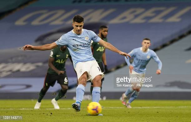 Manchester City's Rodri scores their side's first goal of the game from the penalty spot during the Premier League match at the Etihad Stadium,...