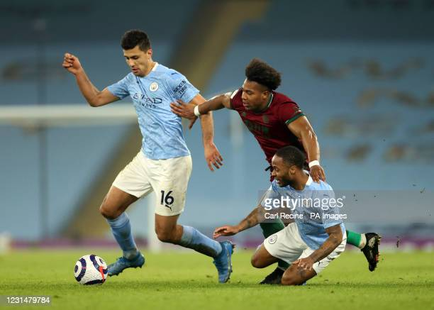 Manchester City's Rodri, Wolverhampton Wanderers' Adama Traore and Manchester City's Raheem Sterling battle for the ball during the Premier League...