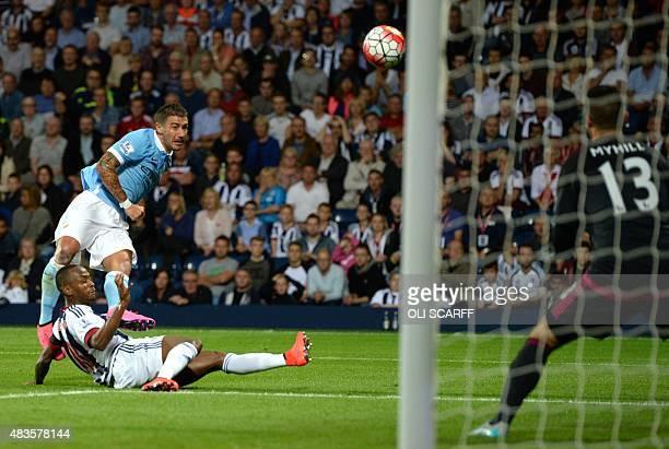 Manchester City's Serbian defender Aleksandar Kolarov has a shot on goal during the English Premier League football match between West Bromwich...