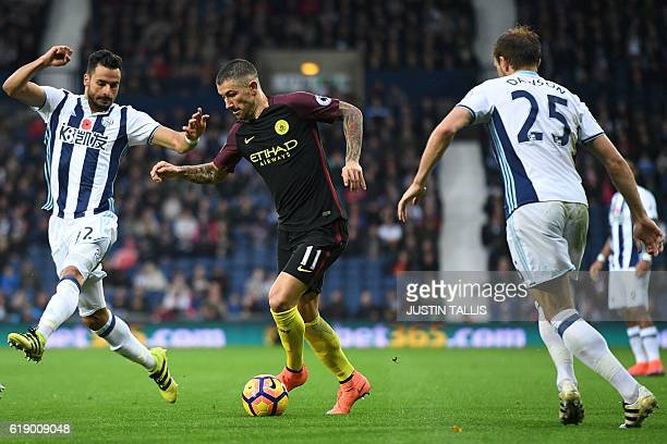 Manchester City's Serbian defender Aleksandar Kolarov vies with West Bromwich Albion's Belgian midfielder Nacer Chadli and West Bromwich Albion's...