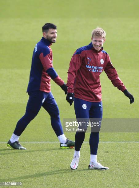 Manchester City's Sergio Aguero and Kevin De Bruyne in action during training at Manchester City Football Academy on February 16, 2021 in Manchester,...