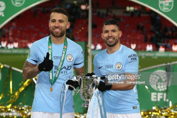 Manchester City's Sergio Aguero and Nicolas Otamendi with the trophy during the Carabao Cup Final match between Arsenal and Manchester City at...
