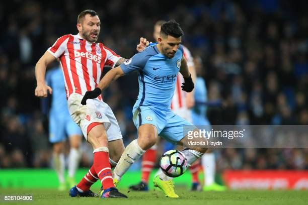 Manchester City's Sergio Aguero and Stoke City's Phil Bardsley battle for the ball