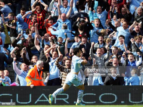 Manchester City's Sergio Aguero celebrates scoring the third goal during the Barclays Premier League match at the Etihad Stadium Manchester