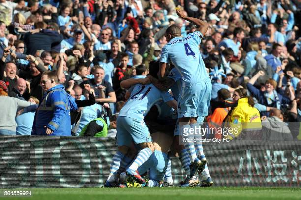 Manchester City's Sergio Aguero celebrates with teammates after scoring the winning goal