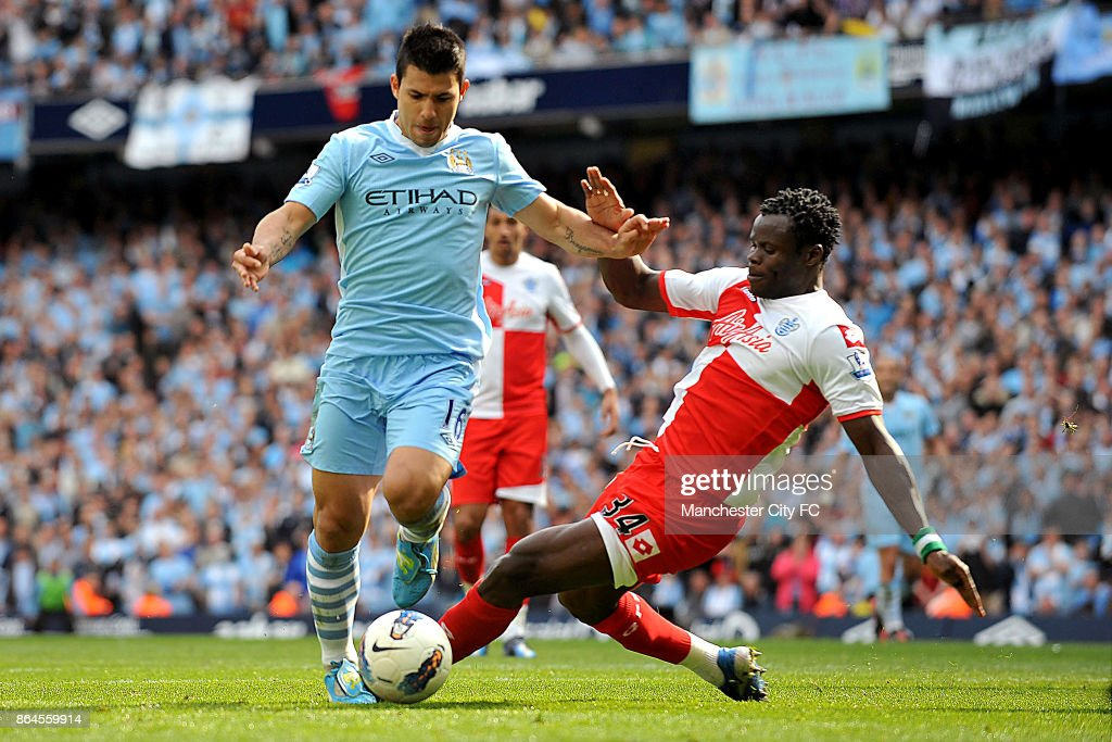 Manchester City's Sergio Aguero goes around Queens Park Rangers' Taye Taiwo to score the winning goall.