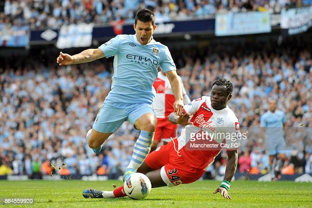 Manchester City's Sergio Aguero goes around Queens Park Rangers' Taye Taiwo to score the winning goall