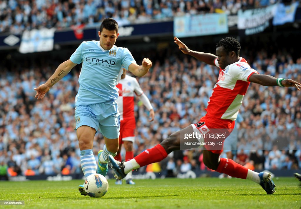 Manchester City's Sergio Aguero goes round Queens Park Rangers' Taye Taiwo to score the winning goall.