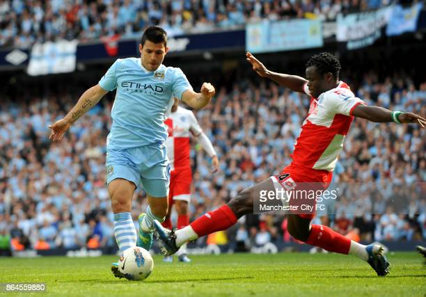 Manchester City's Sergio Aguero goes round Queens Park Rangers' Taye Taiwo to score the winning goall