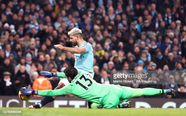 Manchester City's Sergio Aguero has a shot saved by Liverpool goalkeeper Alisson Becker during the Premier League match at the Etihad Stadium...