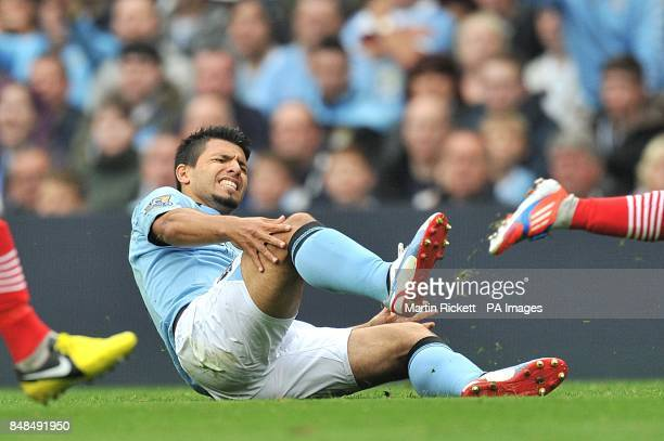 Manchester City's Sergio Aguero holds his knee after a tackle by Southampton's Nathaniel Clyne