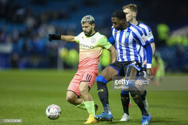 Manchester City's Sergio Aguero in action with Sheffield Wednesday's Moses Odubajoduring the FA Cup Fifth Road match between Sheffield Wednesday and...
