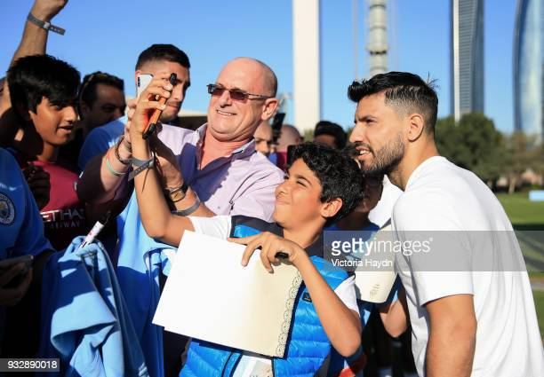 Manchester City's Sergio Aguero interacts with fans during the training session on March 16 2018 in Abu Dhabi United Arab Emirates