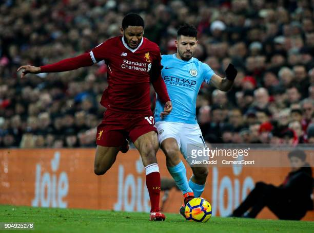 Manchester City's Sergio Aguero is dispossessed by Liverpool's Joe Gomez during the Premier League match between Liverpool and Manchester City at...