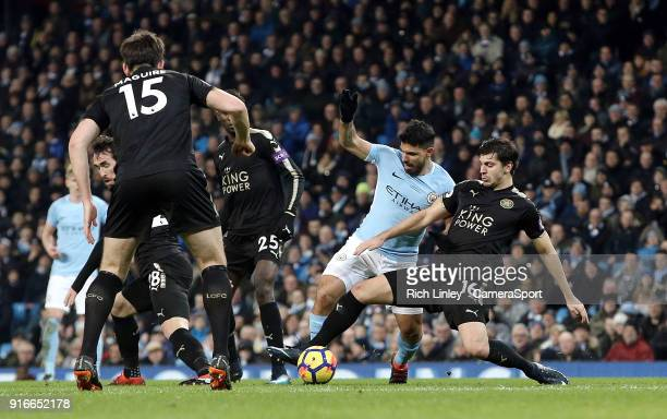 Manchester City's Sergio Aguero is tackled by Leicester City's Aleksandar Dragovic during the Premier League match between Manchester City and...