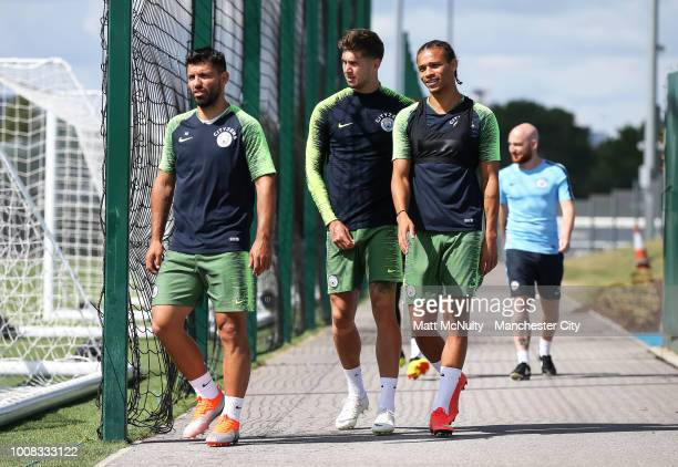 Manchester City's Sergio Aguero John Stones and Leroy Sane during training at Manchester City Football Academy on July 31 2018 in Manchester England