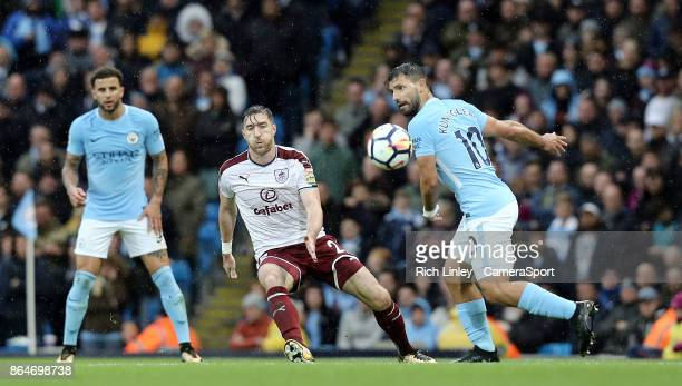 MANCHESTER ENGLAND OCTOBER Manchester City's Sergio Aguero passes under pressure from Burnley's Stephen Ward during the Premier League match between...