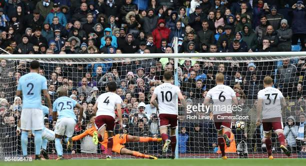 Manchester City's Sergio Aguero scores his sides opening goal past Burnley's Nick Pope from the penalty spot during the Premier League match between...