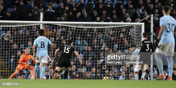 Manchester City's Sergio Aguero scores his side's second goal past Leicester City's Kasper Schmeichel during the Premier League match between...