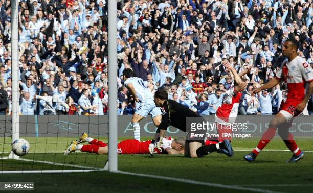 Manchester City's Sergio Aguero scores the third goal during the Barclays Premier League match at the Etihad Stadium Manchester
