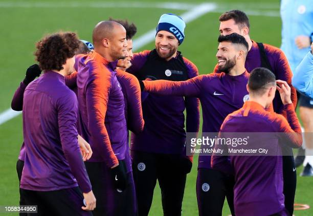 Manchester City's Sergio Aguero shares a joke with Leroy Sane during the open training session at Manchester City Football Academy on November 6 2018...